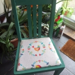 1953 painted Oak Upright Chair seat recovered with Chick motif.